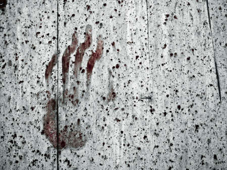 Eerie and spooky handprint on an old chapel door photo