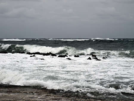med: Rocky coastline during windy weather in the Med