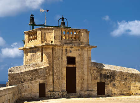 portcullis: The siege bells at St Michaels Bastion at the medieval citadel in Gozo Malta