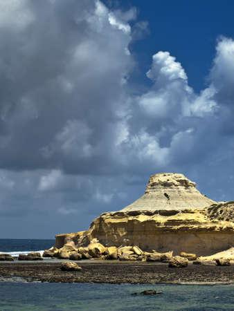 hillock: The White Hillock in Gozo in the Maltese Islands also known as Qolla s-Safra