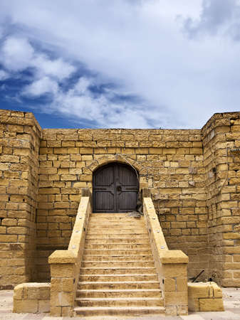 portcullis: Medieval castle or fortress with highly eroded walls in the island of Gozo Stock Photo