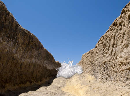 sudden: A sudden flash flood fills a dry and arid valley