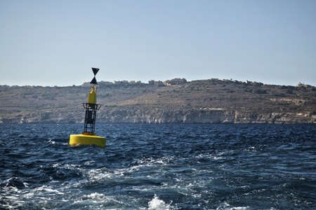 A reef hazard marker buoy off the coast of Comino in Malta. Stock Photo - 10335698