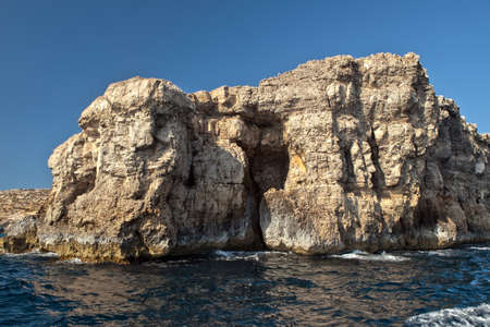 characterized: The coast of the small island of Comino in Malta is characterized by jagged high cliffs and various caves.
