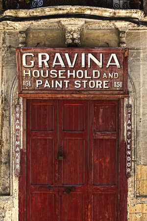 evoke: VALLETTA, MALTA - JUN 22 - The capital city of Malta, Valletta, is a treasure trove for photographers.  Many small business have closed down during the years, but their quaint little shop signs still stand. These little details evoke a nostalgic travel th