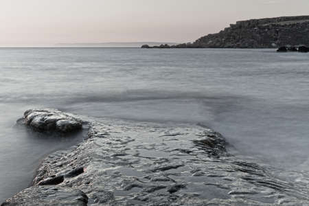 icey: Detail of a rocky reef with a surreal, cold feel.