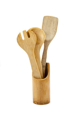 cooking ware: Wooden kitchen utensils over white backdrop