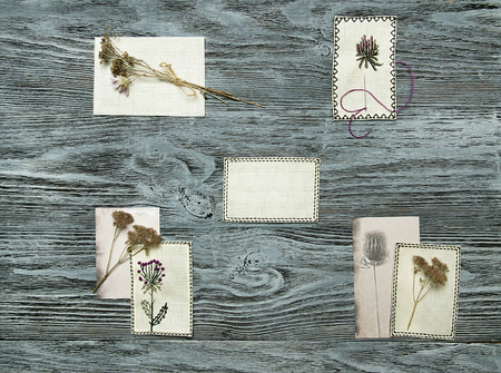 Embroidered flowers on white canvas. Rustic background