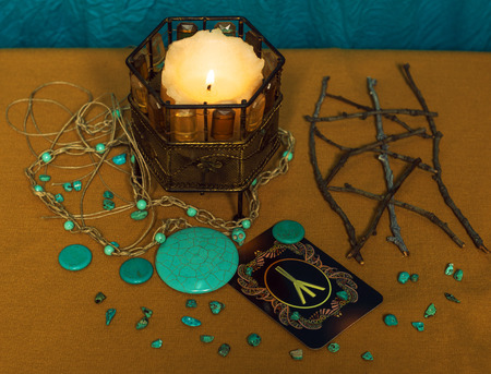 Fate: Still life with magical items. Scandinavian tree of life.Rune Algiz. Stock Photo