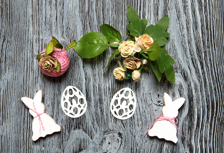 Easter symbols on wooden background. Wiccan Ostara abstract symbols