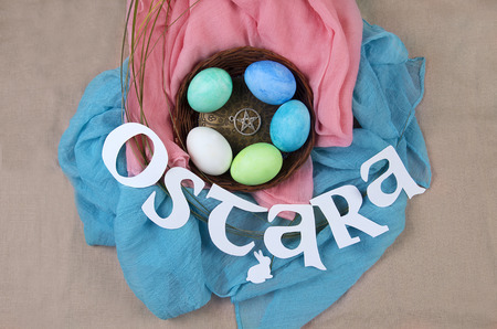 Symbols of Ostara sabbath celebration, colored eggs, rabbits.