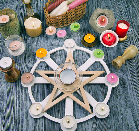Altar with Wheel of year, pentagram and colorful candles