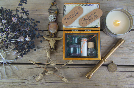 Black magic ingredients  with old recipes. Occult, esoteric, divination and wicca concept. Mystic and vintage background Stock Photo