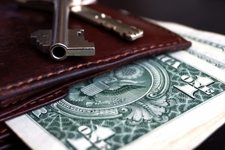 operating key: Old purse - a wallet with shabby American banknotes inside and keys from above