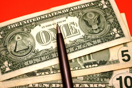 trouble free: The pen on shabby American banknotes indicates one dollar, a red background