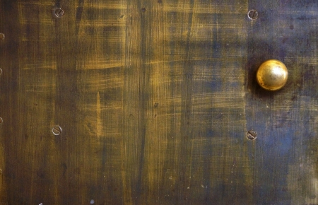 Ancient small door on a fireplace from brass with the round handle photo