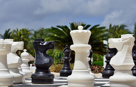 Big black and white figures for game in chess on a beach during rest Stock Photo - 20447177