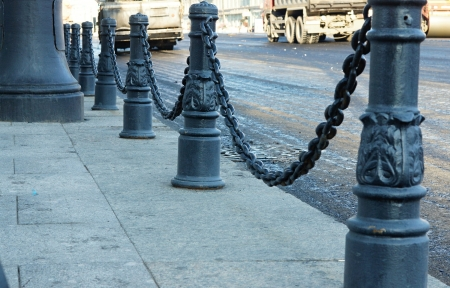 Black iron columns with chains against road repair Stok Fotoğraf