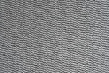 背景と表面の黒い色のサテンからの生地のテクスチャ