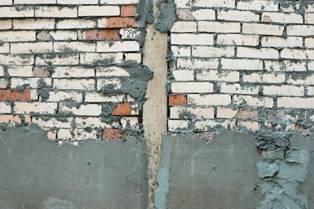 subsequent: Repair of a brick wall with the subsequent plaster Stock Photo