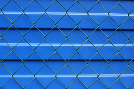 Metal protection of a blue profile leaf and green grid from above photo