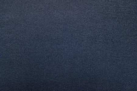 Textura azul-gris de la tela de un material textil de un fondo abstracto, de una superficie vacía y por el empapelado