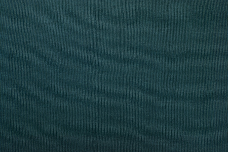 Gray-green texture of fabric from a textile material for an abstract background, for an empty surface and for wall-paper photo