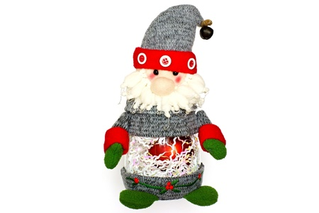 The Christmas toy of Santa Claus for the festive fir-tree, isolated on a white background, attentively and cheerfully looks photo
