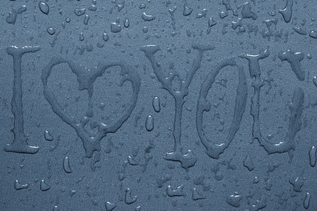 Inscription I love you and water drops on a gray background photo