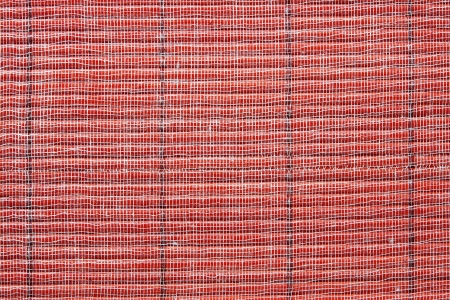 Basis: Texture of a red straw mat with a basis from a gauze for an abstract background