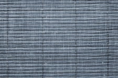 Basis: Texture of a silvery straw mat with a basis from a gauze for an abstract background