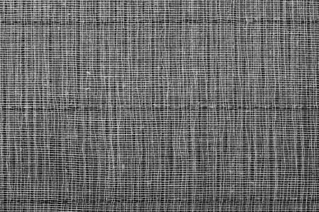 Basis: Texture of a black straw mat with a basis from a gauze for an abstract background Stock Photo
