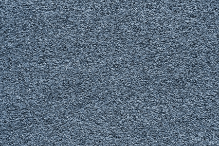 granular: Granular texture of a dark gray abrasive material for an abstract background