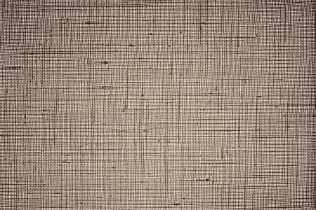 Texture of dense brown fabric closeup against bright light of a white lamp for abstract backgrounds and wallpaper photo
