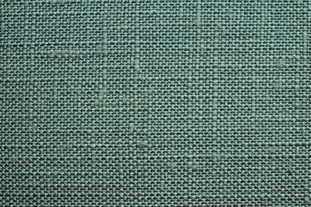 dense mats: Texture of rough dense fabric for an emerald background and abstract wallpaper, a closeup Stock Photo