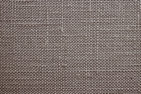 Texture of rough dense fabric for a silvery-brown background and abstract wallpaper, a closeup photo