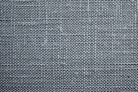 dense mats: Texture of rough dense fabric for a silvery background and abstract wallpaper, a closeup Stock Photo