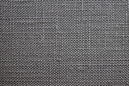 dense mats: Texture of rough dense fabric for a black background and abstract wallpaper, a closeup Stock Photo