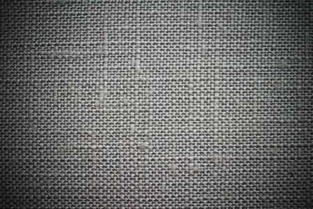 dense mats: Texture of rough dense fabric for an ashy background and abstract wallpaper, a closeup Stock Photo
