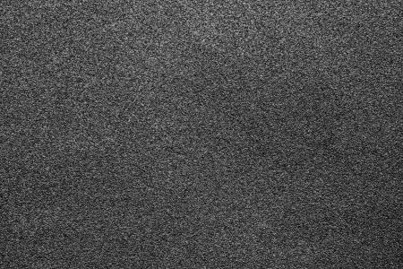 壁紙と抽象的な背景に黒の研磨材のきめの細かい風合い