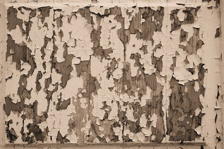 peeledoff: Texture of the old peeled-off paint with toning by sepia for an abstract background Stock Photo