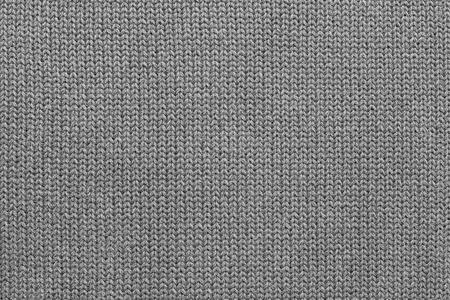 모직 또는 니트 직물의 추상 질감의 배경에서 회색 원사 weaved