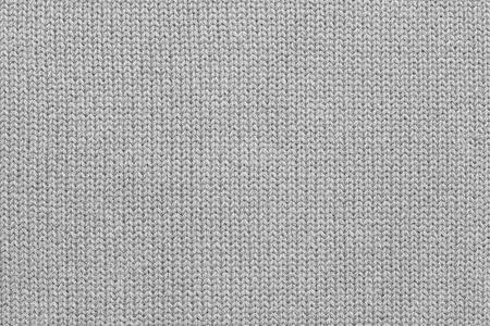灰色の糸から編まれたウールまたはニット生地の抽象的なテクスチャの背景 写真素材