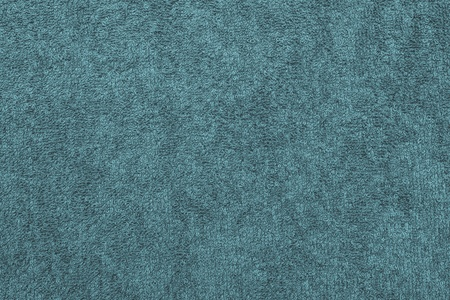 abstract texture terry cotton fabric closeup for a turquoise background