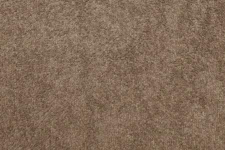 茶色の背景の抽象的なテクスチャ テリー綿生地クローズ アップ