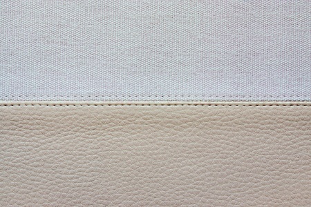 stitched: abstract background from a combination of textures of an imitation leather and rough fabric