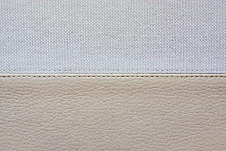 imitation leather: sfondo astratto da una combinazione di trame di un similpelle e tessuto grezzo