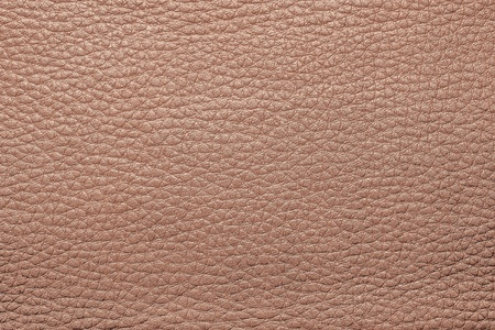 abstract background from the painted texture of skin and leather fabric terracotta color photo