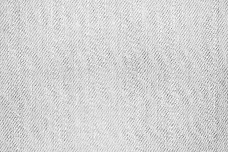 抽象的な白い色の背景のためのデニムのテクスチャを塗装