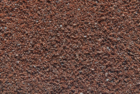 texture of powder of ground coffee of natural color for an abstract background closeup photo